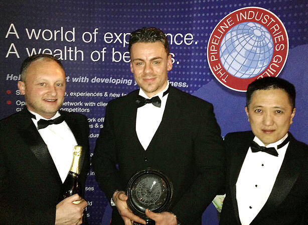 the team at Tracerco accept the award for most significant contribution to subsea pipeline technology for Discovery from the Pipeline Industries Guild